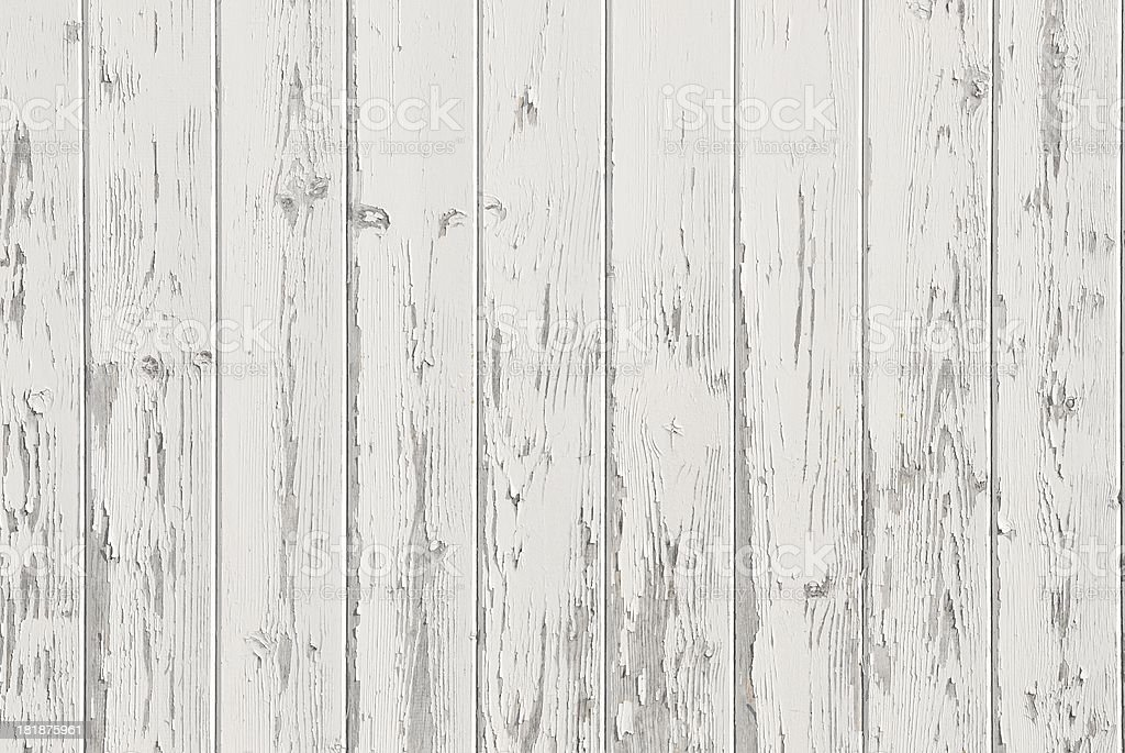 Old weathered wood panels with peeling white paint royalty-free stock photo