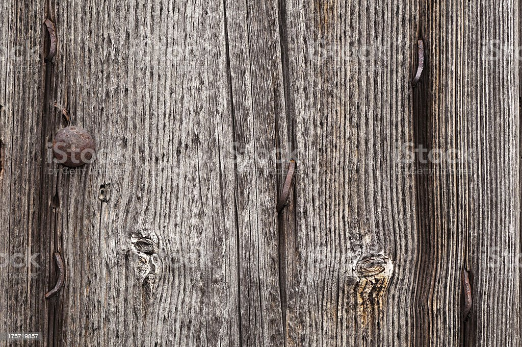 Old weathered wooden board with rusty nails stock photo