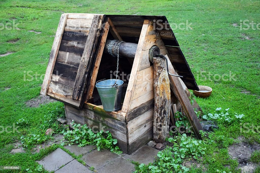 Old well in the village stock photo