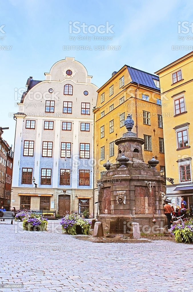 Old well on Stortorget square, a small public squar stock photo