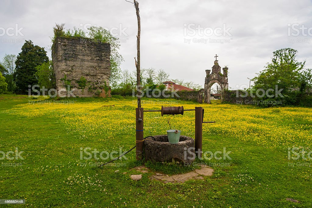 old well with iron bucket stock photo