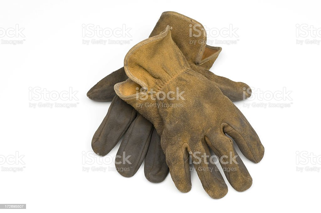 Old well worn leather work gloves-isolated on white stock photo