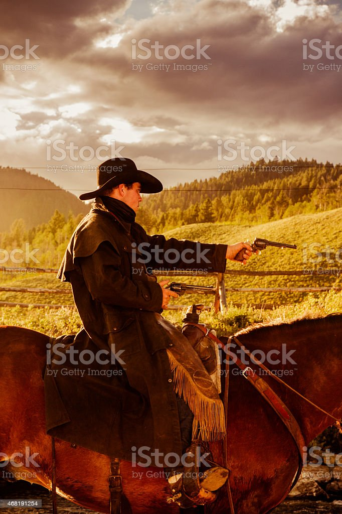 Old West Bandit On His Horse Aiming A Gun stock photo