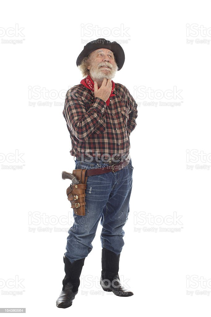 Old West cowboy stands scratching his beard stock photo