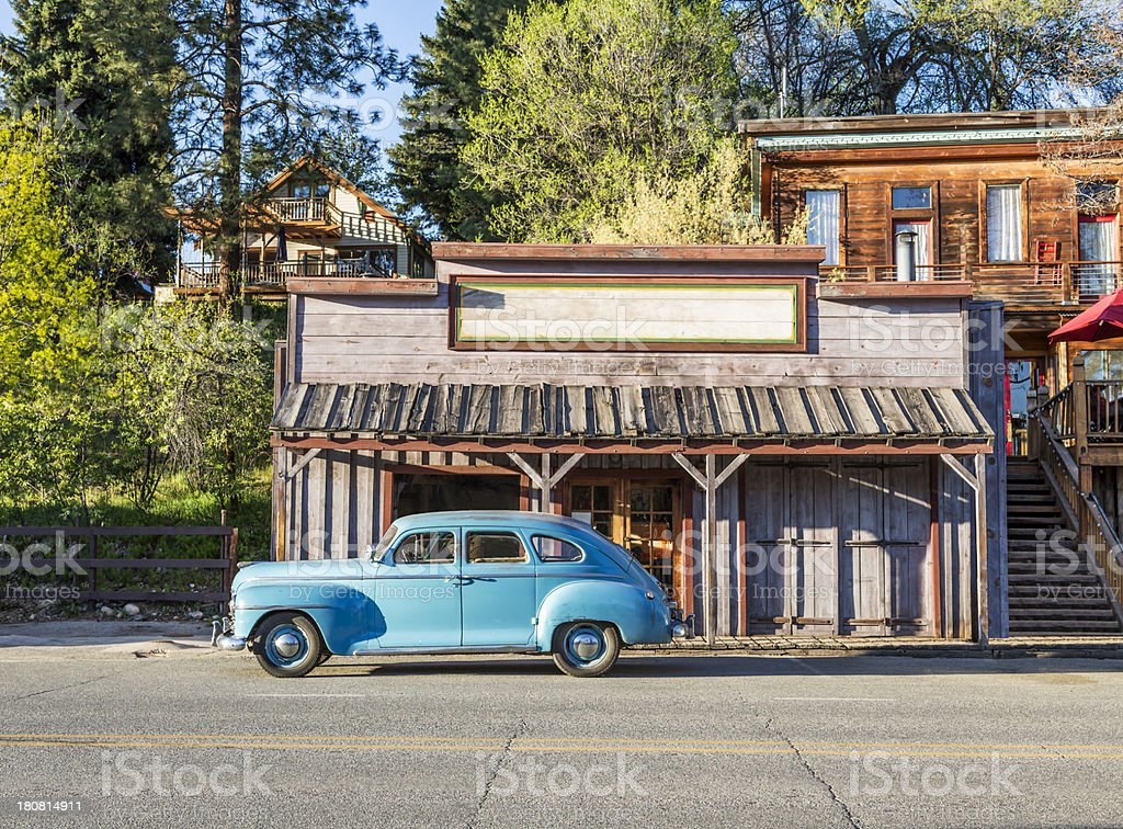 Old West Storefront with Vintage car parked in front stock photo