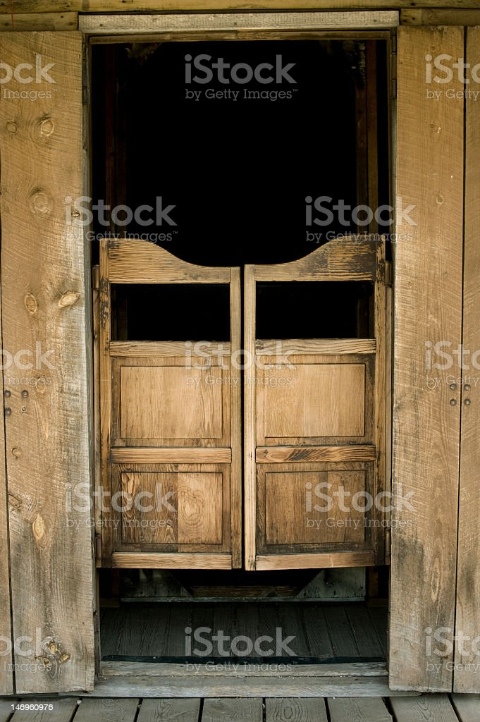 Old west style saloon doors and frame with black background stock photo