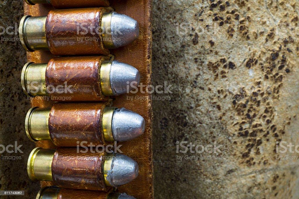 Old Western Bandolier Belt with Colt 45 Bullets stock photo