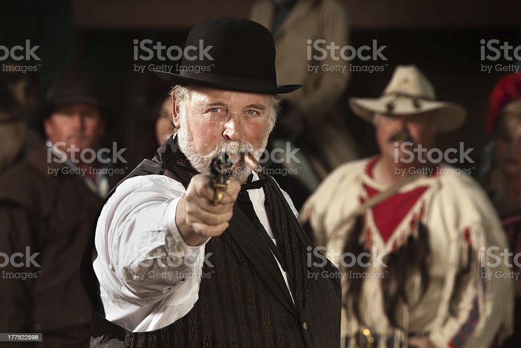 Old Western Smoking Man with Gun stock photo