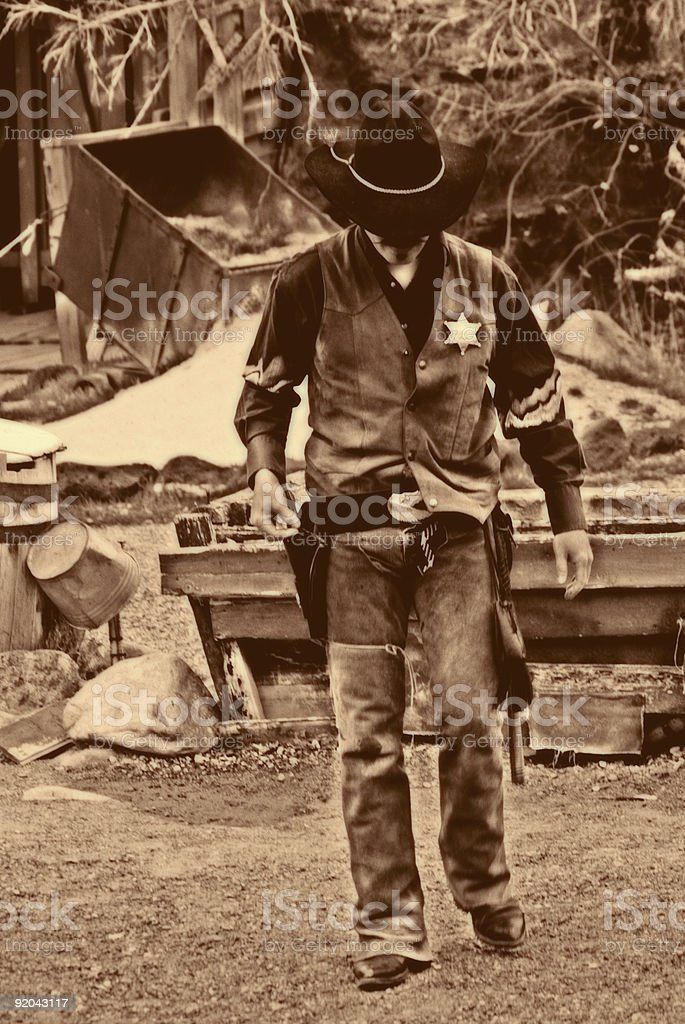 Old West--Sheriff Walks Alone stock photo