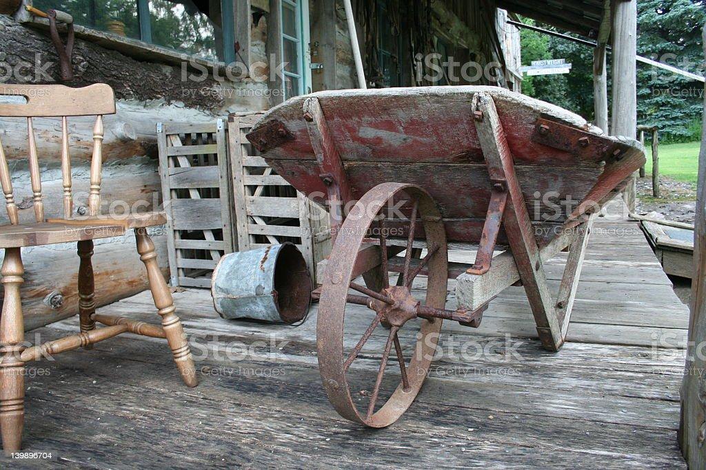 old wheel barrel stock photo