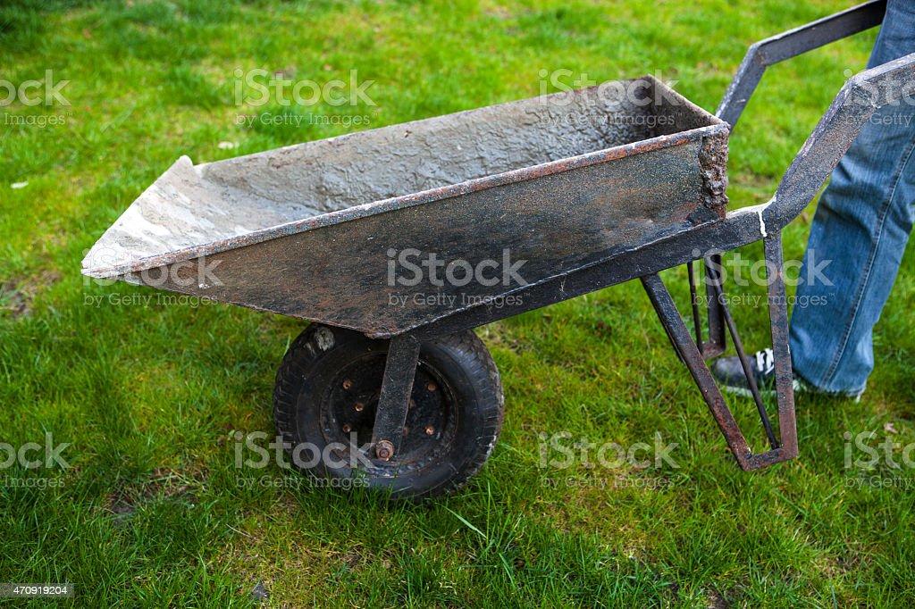 Old wheelbarrow on the lawn stock photo