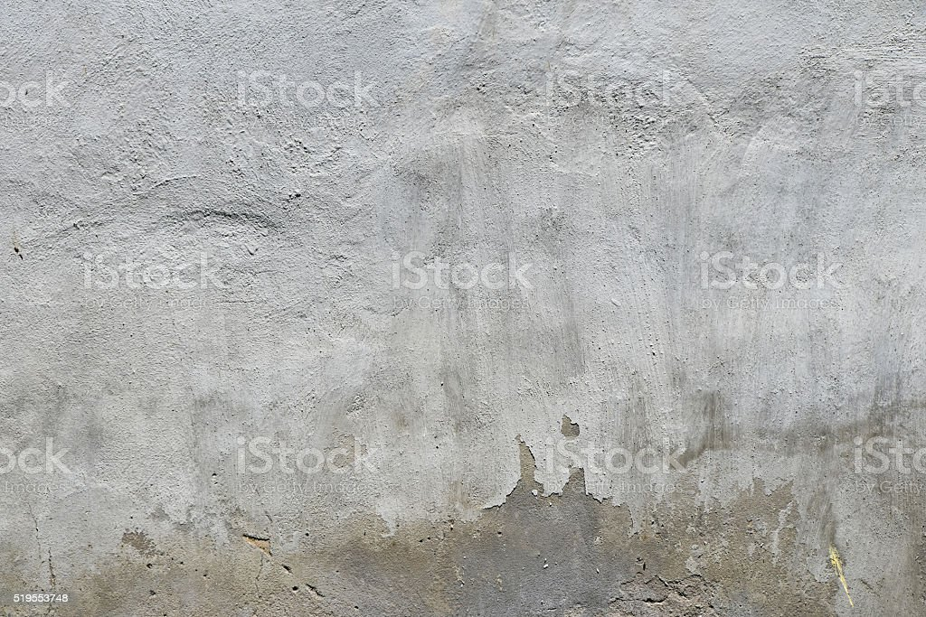 Old white and grey painted concrete wall with weatherstains royalty-free stock photo