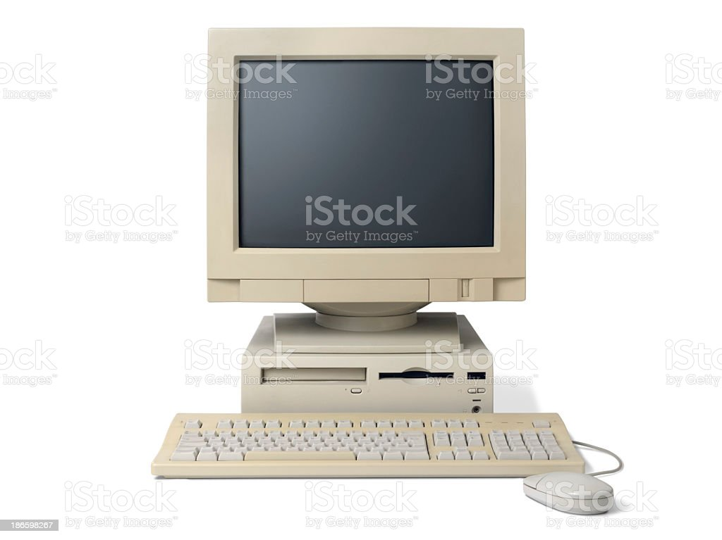 Old, white, desktop PC computer with a keyboard and mouse stock photo