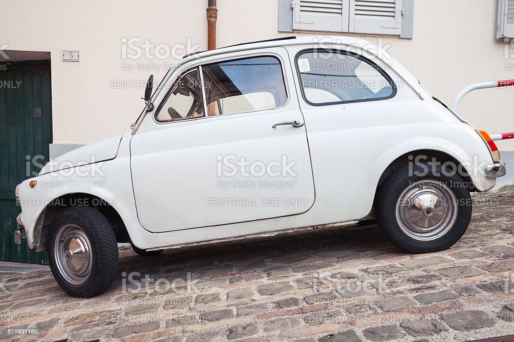 Old white fiat 500 L city car side view stock photo