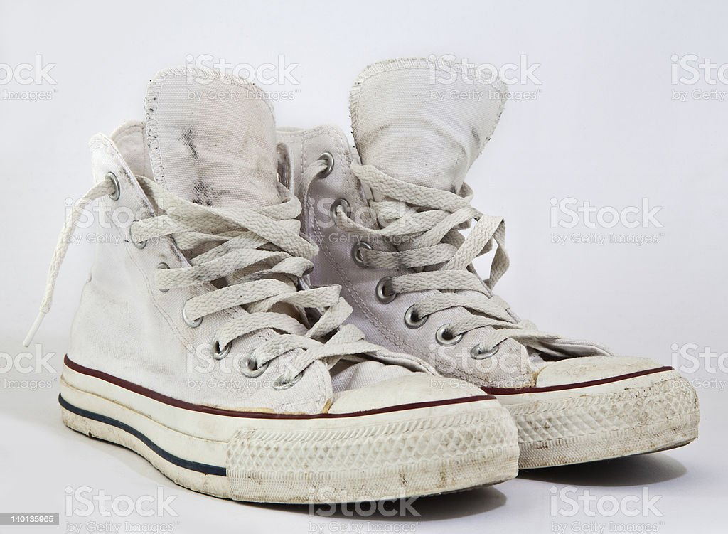Old white sneakers stock photo