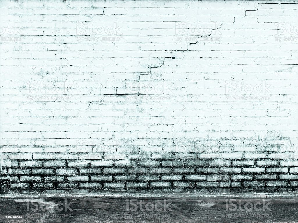 Old white wall with cracks in stepped shape royalty-free stock photo