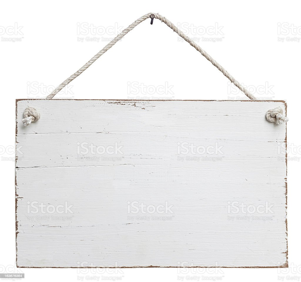 Old, white weathered signboard hanging by a string stock photo