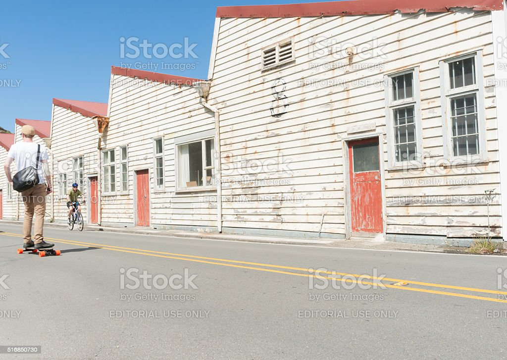 Old white weathered warehouse buildings Shelly Beach Road, Miramar stock photo