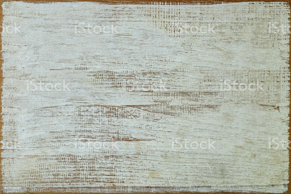 Old white weathered wood board background with lots of character. stock photo
