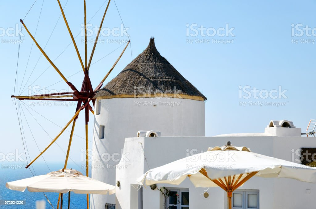 Old white windmill on Santorini island, Greece stock photo