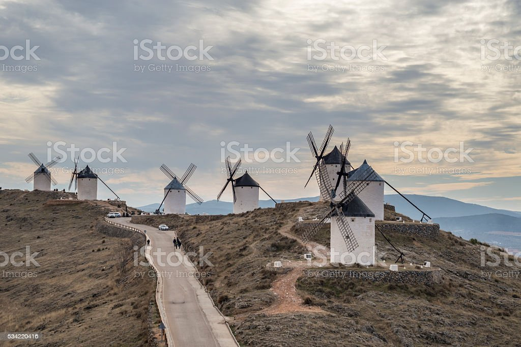 Old white windmills in Consuegr, province of Toledo, stock photo