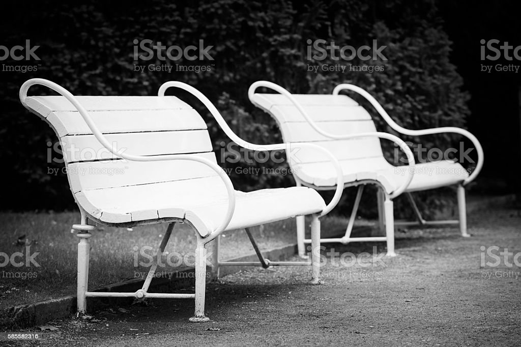 old white wooden benches stock photo