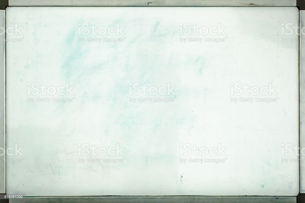 Old whiteboard for office with traces of stains and spots stock photo