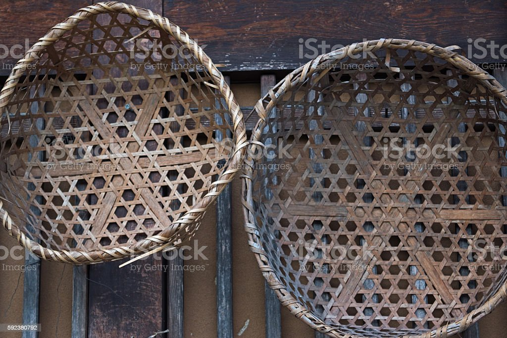 Old wicker basket bamboo and wooden wall stock photo