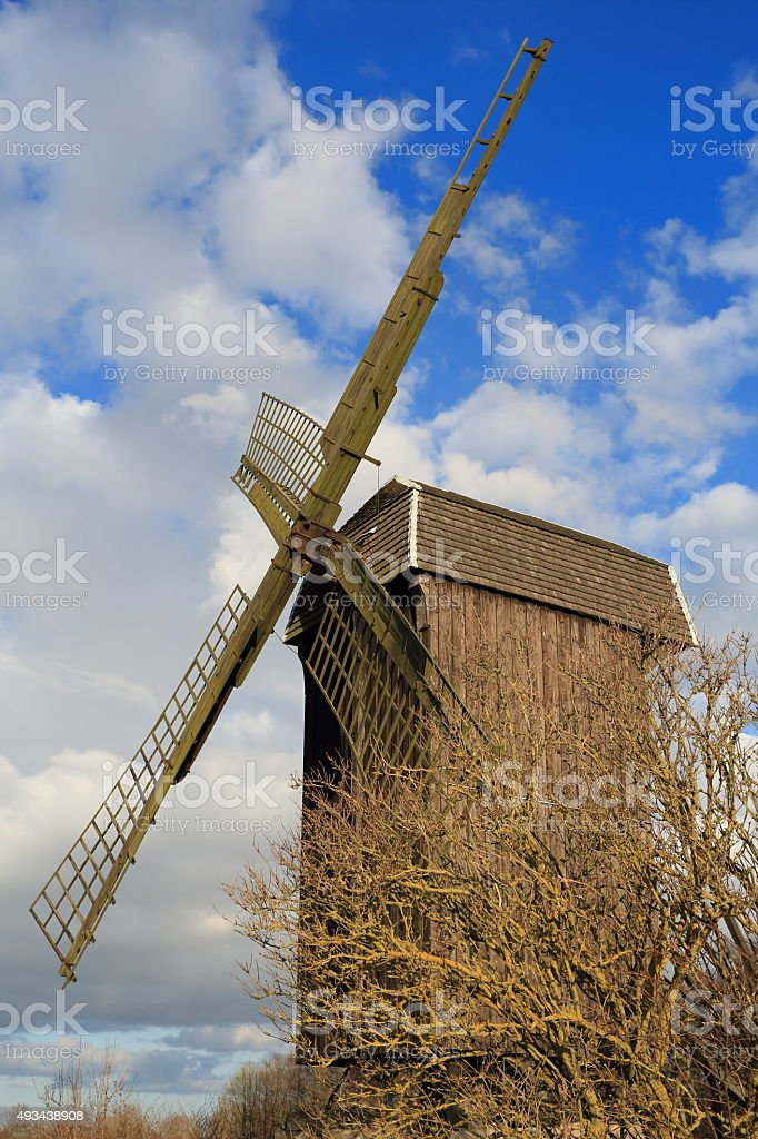 Old windmill and farm land stock photo