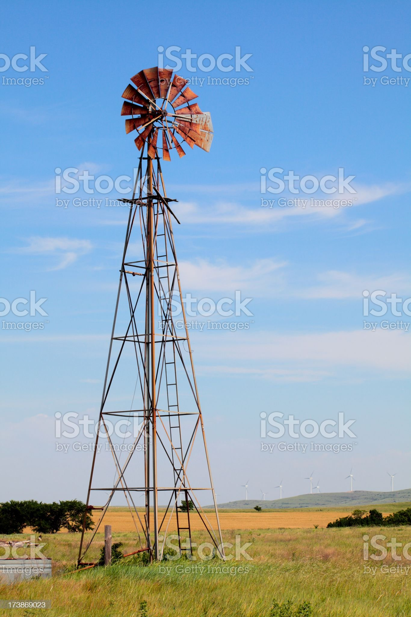 Old Windmill and New Wind Turbines in background royalty-free stock photo
