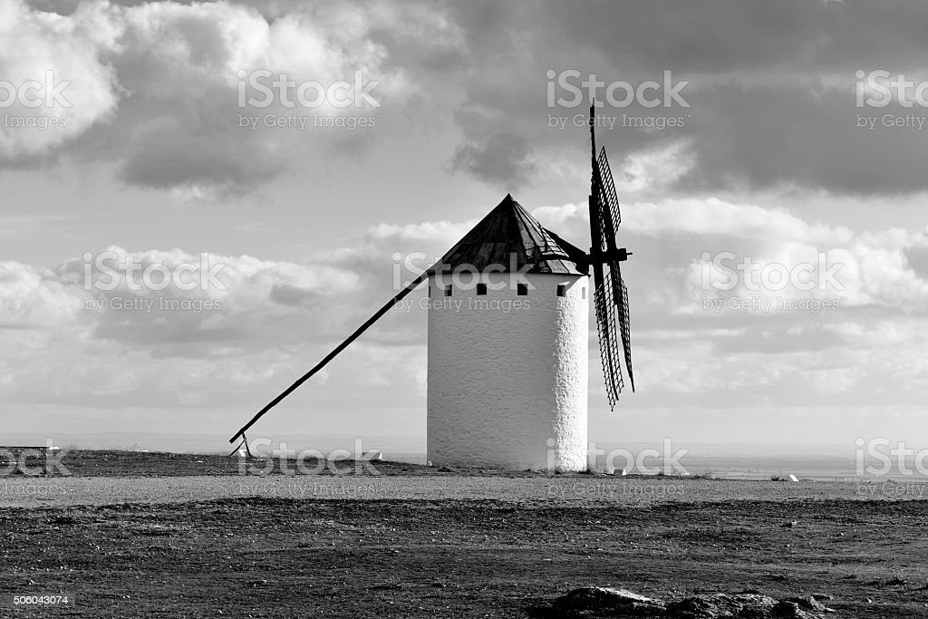 old windmill in Campo de Criptana, Spain, black and white stock photo