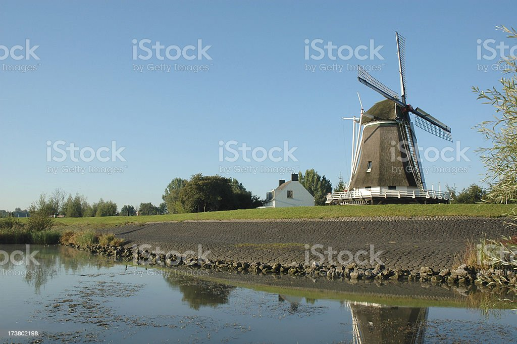 Old windmill on a dutch levee royalty-free stock photo