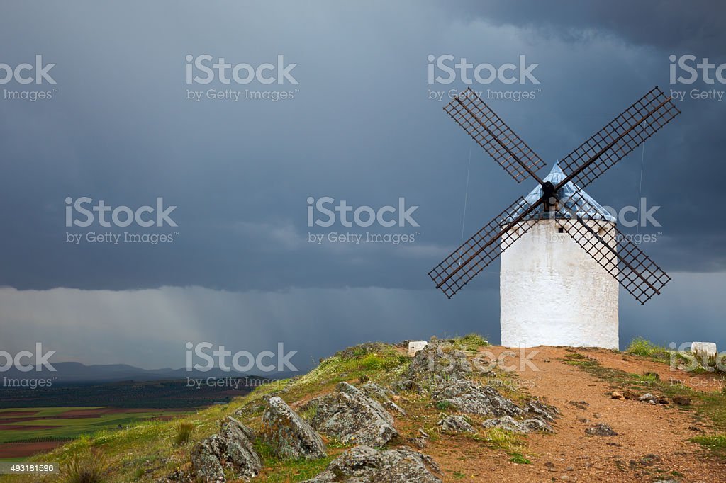 Old  Windmill on dramatic sky and rain stock photo