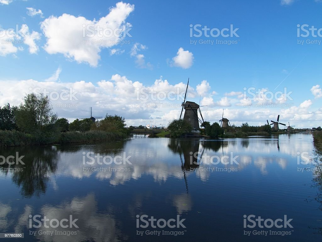 old windmills after raining royalty-free stock photo