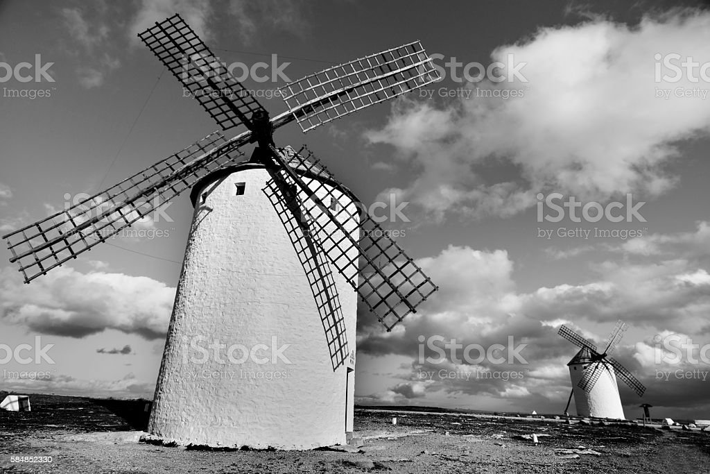 old windmills in Campo de Criptana, Spain, black and white stock photo