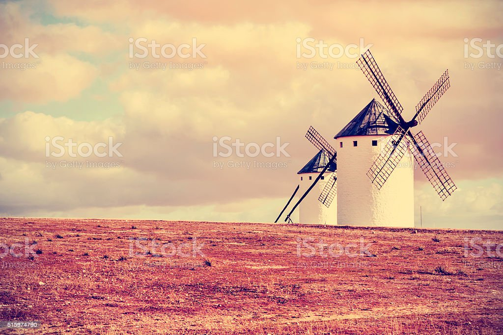 old windmills in Campo de Criptana, Spain, filtered stock photo