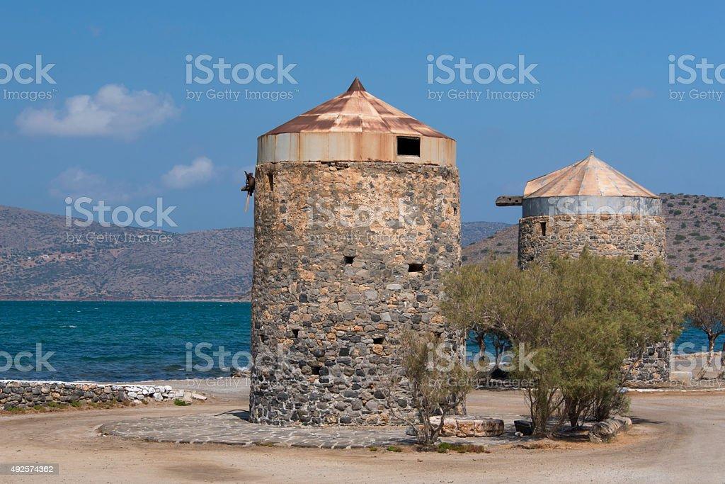 Old windmills in Crete stock photo