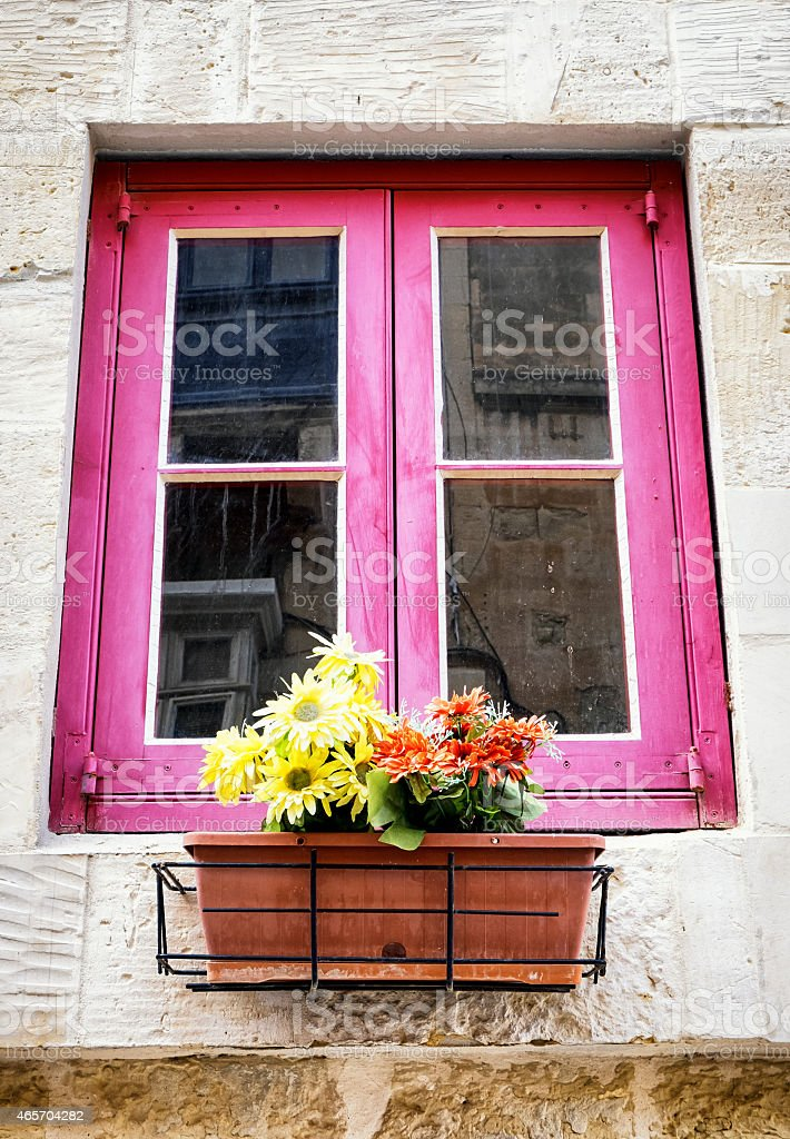 old window and flowers stock photo
