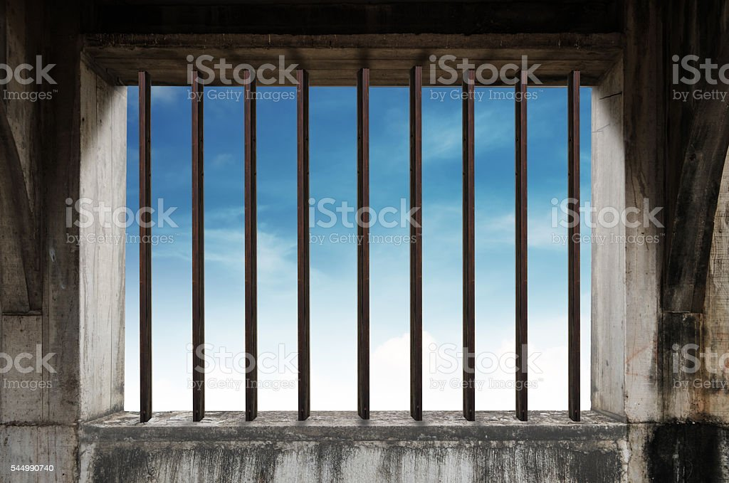 Old window frame with iron bar in jail stock photo