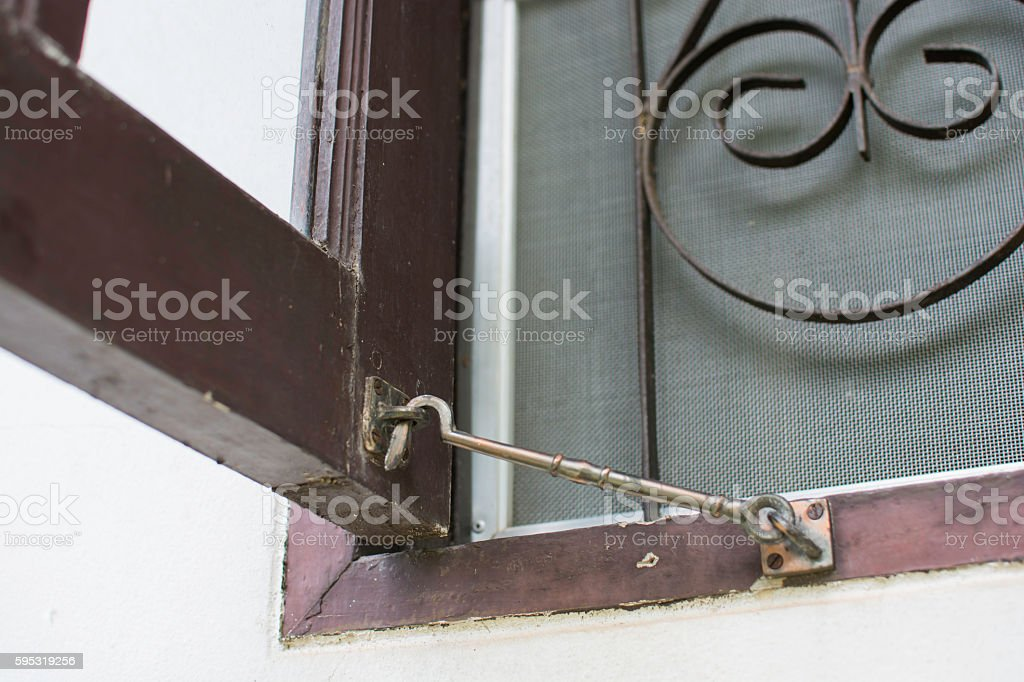 Old window hook with wooden window royalty-free stock photo