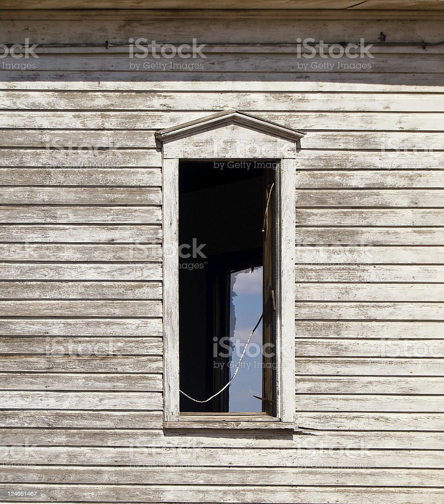 Old window in wooden abandoned house royalty-free stock photo