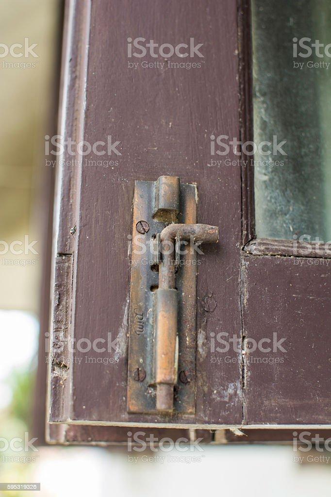 Old window lock on wooden window royalty-free stock photo