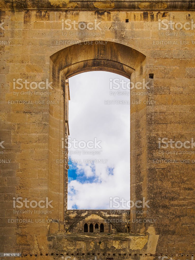 Old window of Narbonne's cathedral with sky at its background stock photo