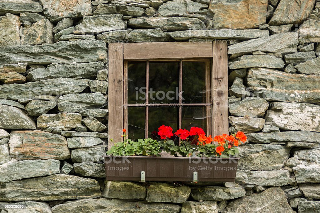 Old Window of the stone house in Alps stock photo