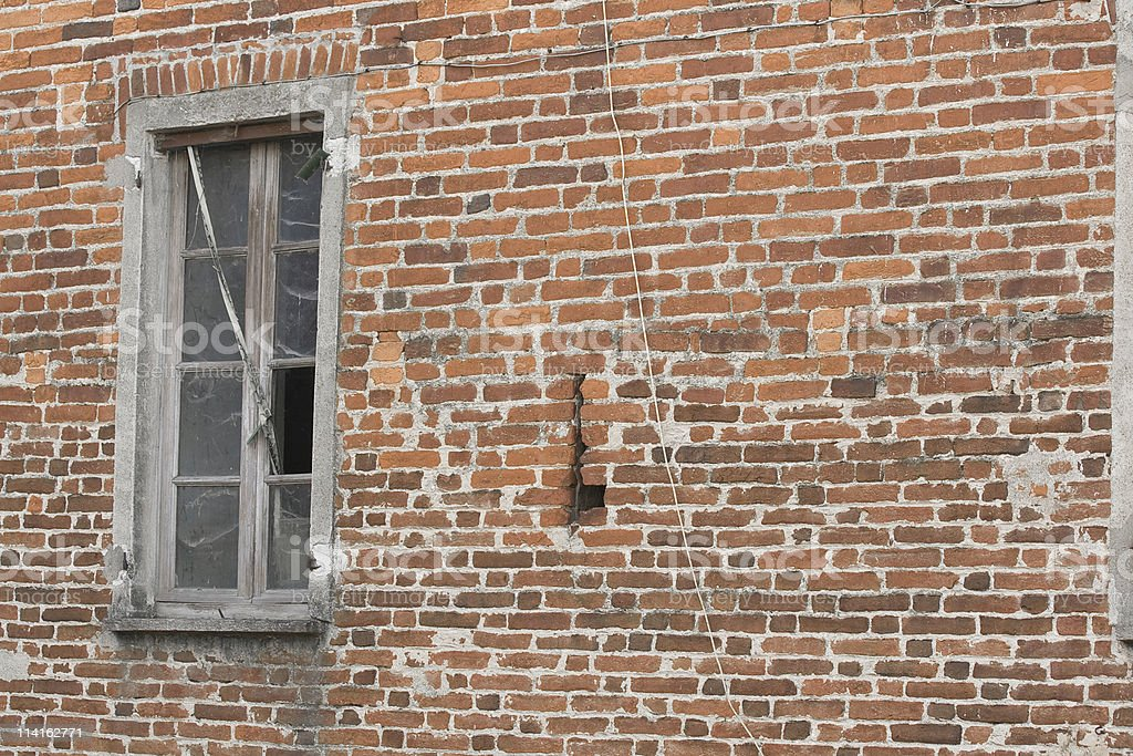 Old window on a red brick wall stock photo