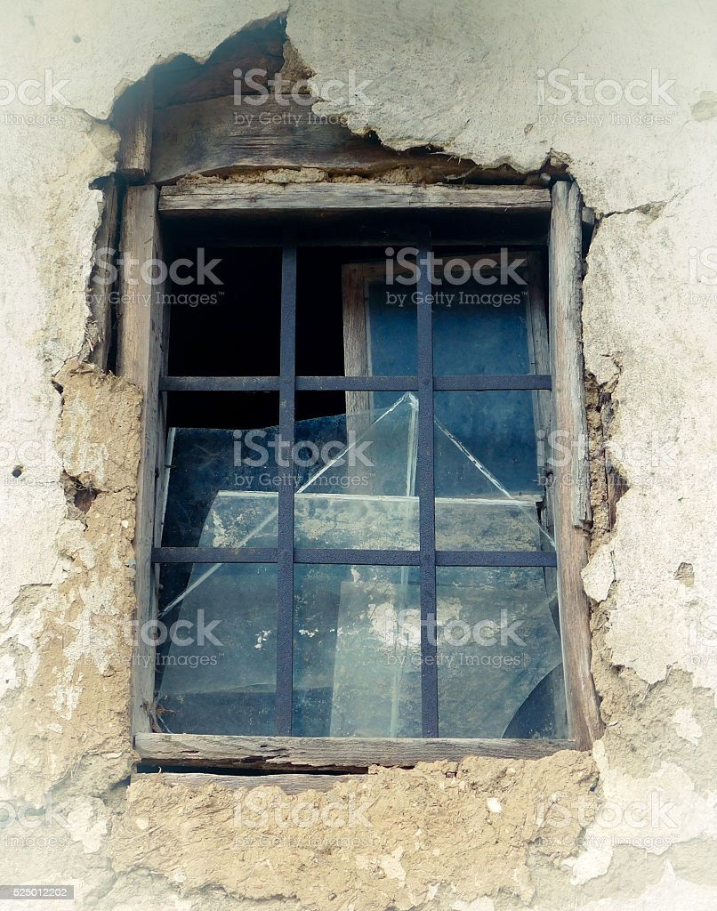 Old window on ruined wall stock photo