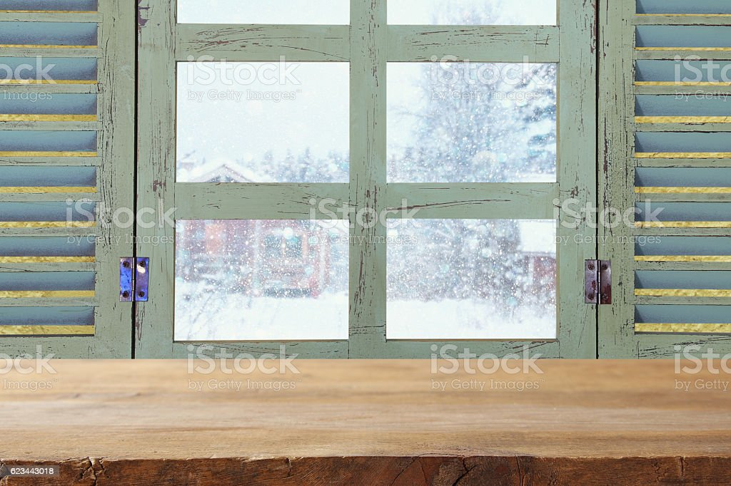 Old window sill in front of dreamy winter landscape stock photo