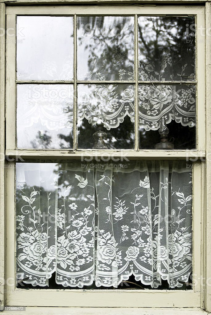 Old Window with Lace Curtains stock photo