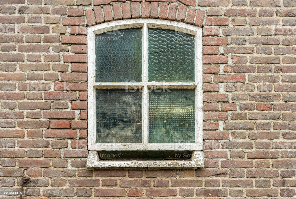 Old window with reinforced glass from close stock photo