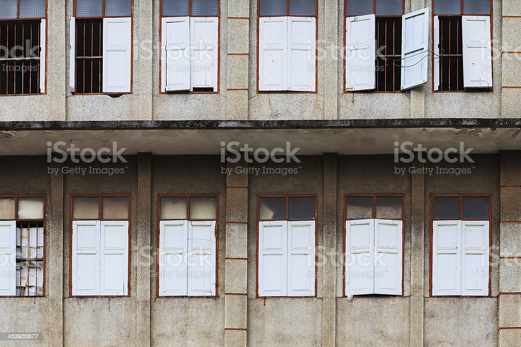 Old windows on ruin house royalty-free stock photo